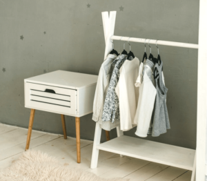 A clothing rack with basic items of clothing to create a capsule wardrobe