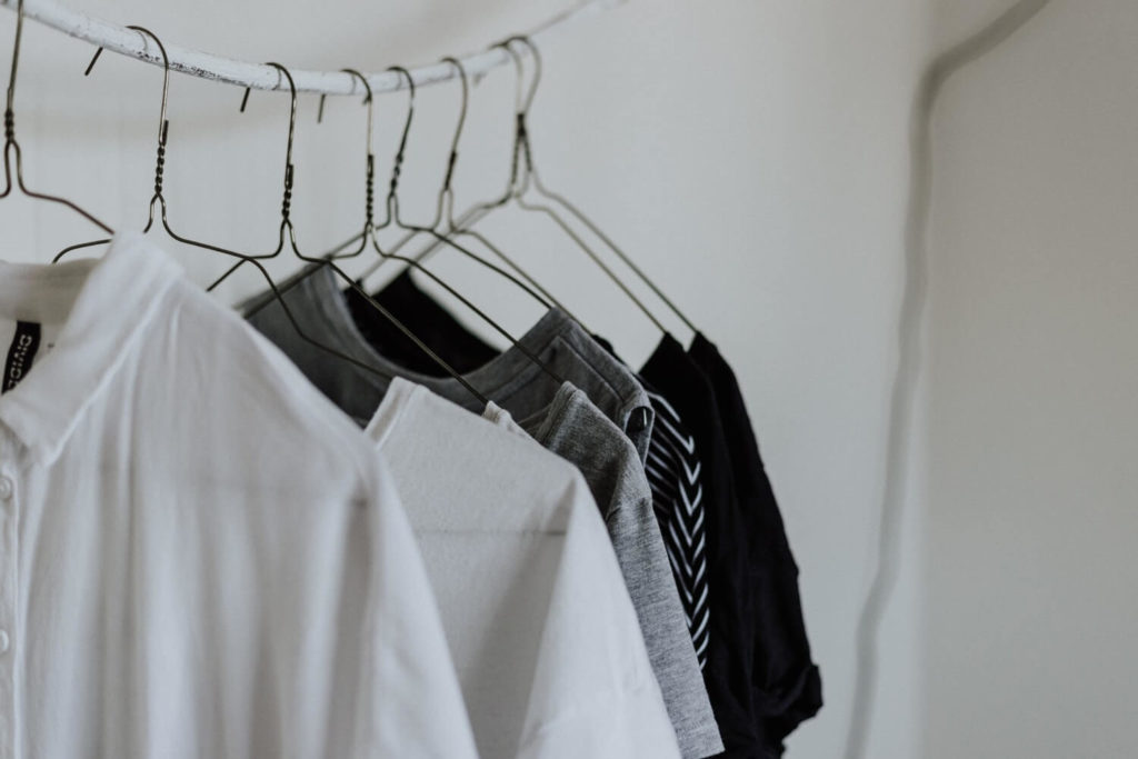 A capsule wardrobe of hanging clothes