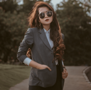Woman wearing a suit and sunglasses