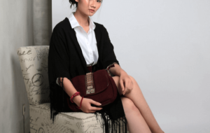 Woman wearing formal clothes and holding a clutch bag
