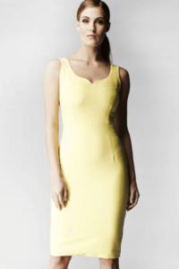 Woman wearing a pale yellow pencil dress