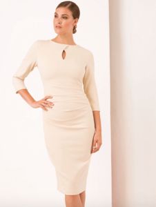 Woman wearing a cream or off-white wiggle dress