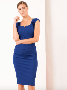 Woman wearing a blue, sleeveless wiggle dress