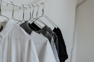 A clothing rail of basic, sustainable clothes on hangers