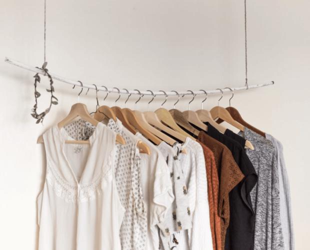 Capsule wardrobe of clothes hanging on a clothes hanger