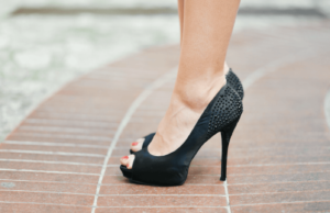 Woman wearing a pair of high heeled shoes
