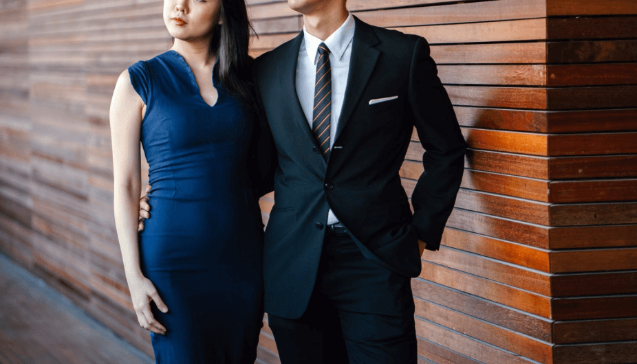 Couple wearing formal dress and suit for the races