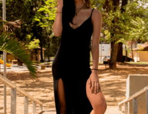Woman wearing a black strapless dress with slits