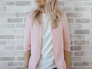 Woman wearing pink suit blazer with white t shirt
