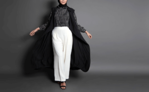 Woman wearing modest fashion essentials including white palazzo pants and a stripy shirt