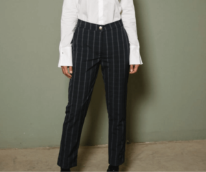 Woman wearing comfortable black striped trouser and blouse