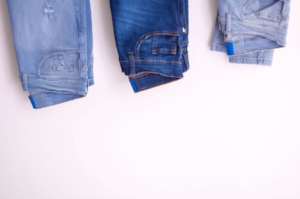 Three different shades of blue jeans for each pregnancy trimester