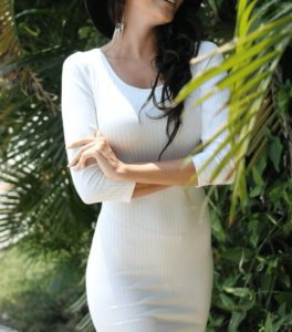 Woman wearing a white bodycon dress