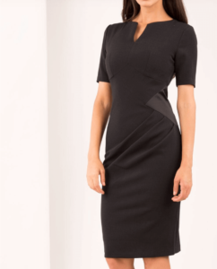 Woman wearing a black sheath dress that can be worn to work