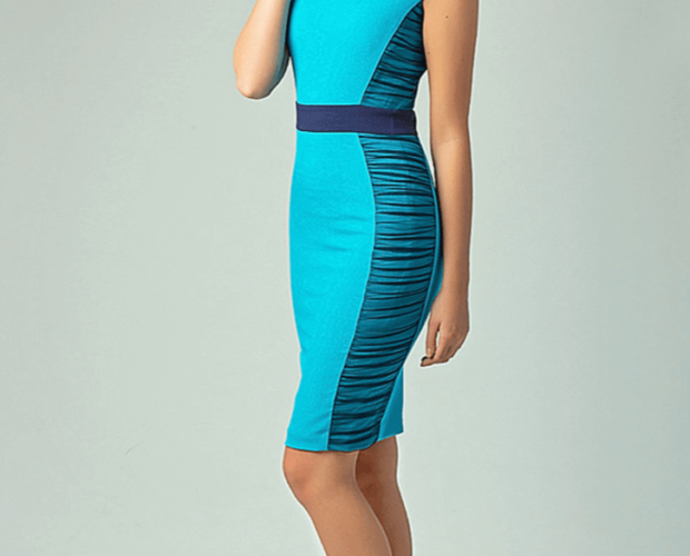 Woman wearing a blue, retro, vintage wiggle dress