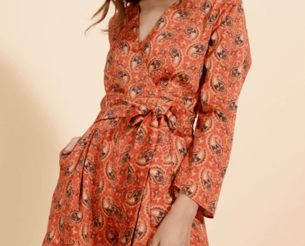 Woman wearing an orange print wrap dress