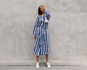 Woman wearing a blue and white striped wrap dress