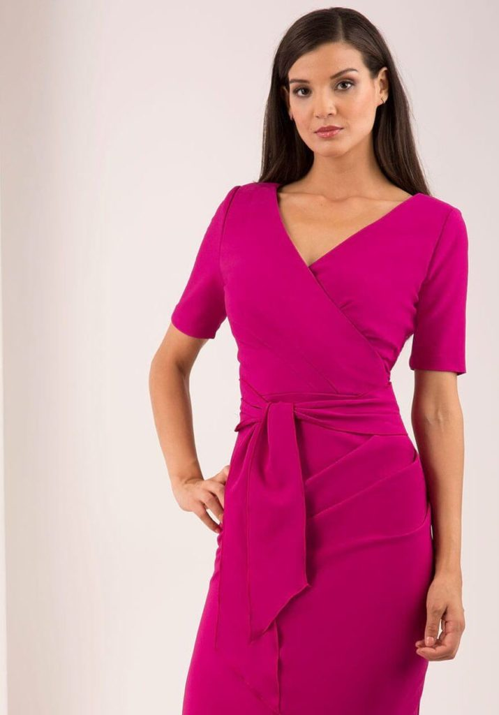model wearing HYBRID LIV MAGENTA CREPE WRAP DRESS