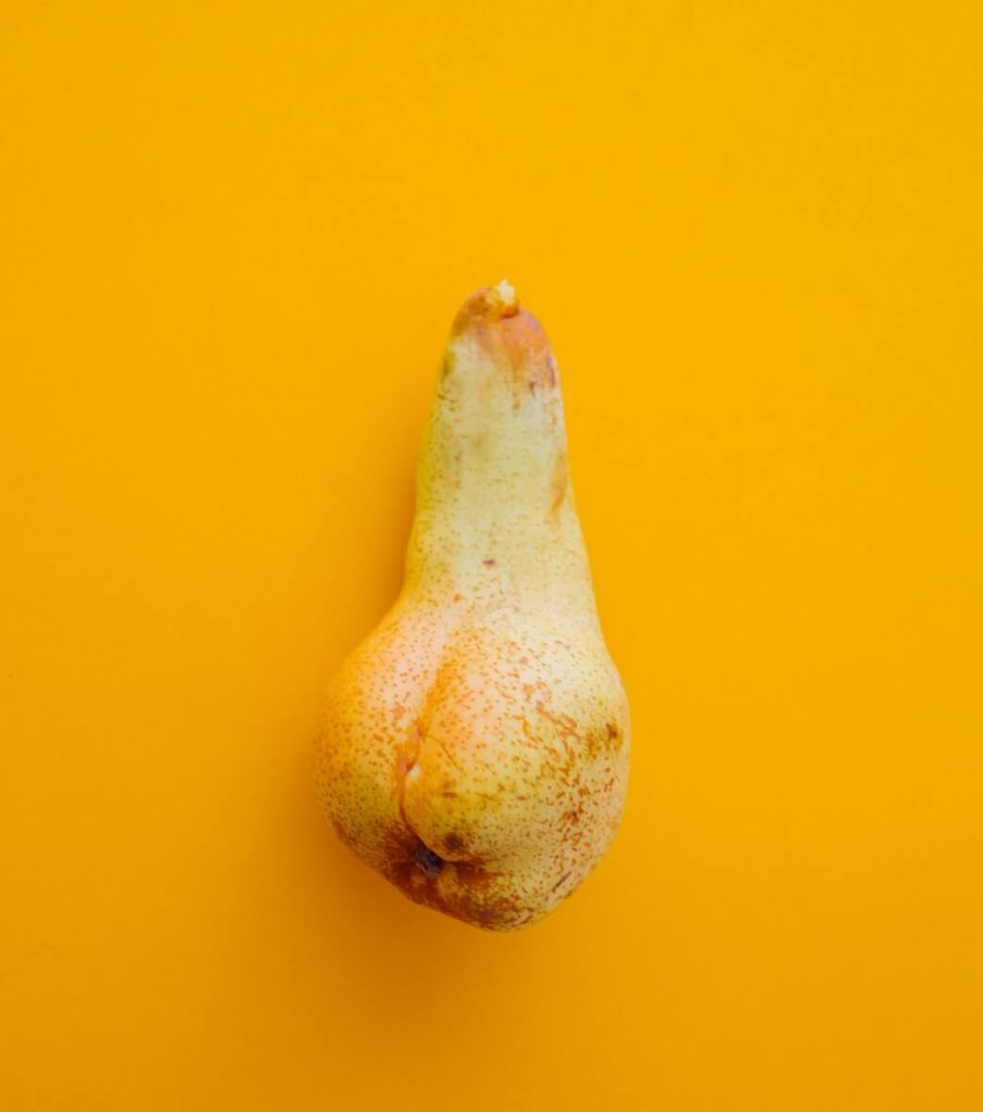 yellow pear on bright yellow background